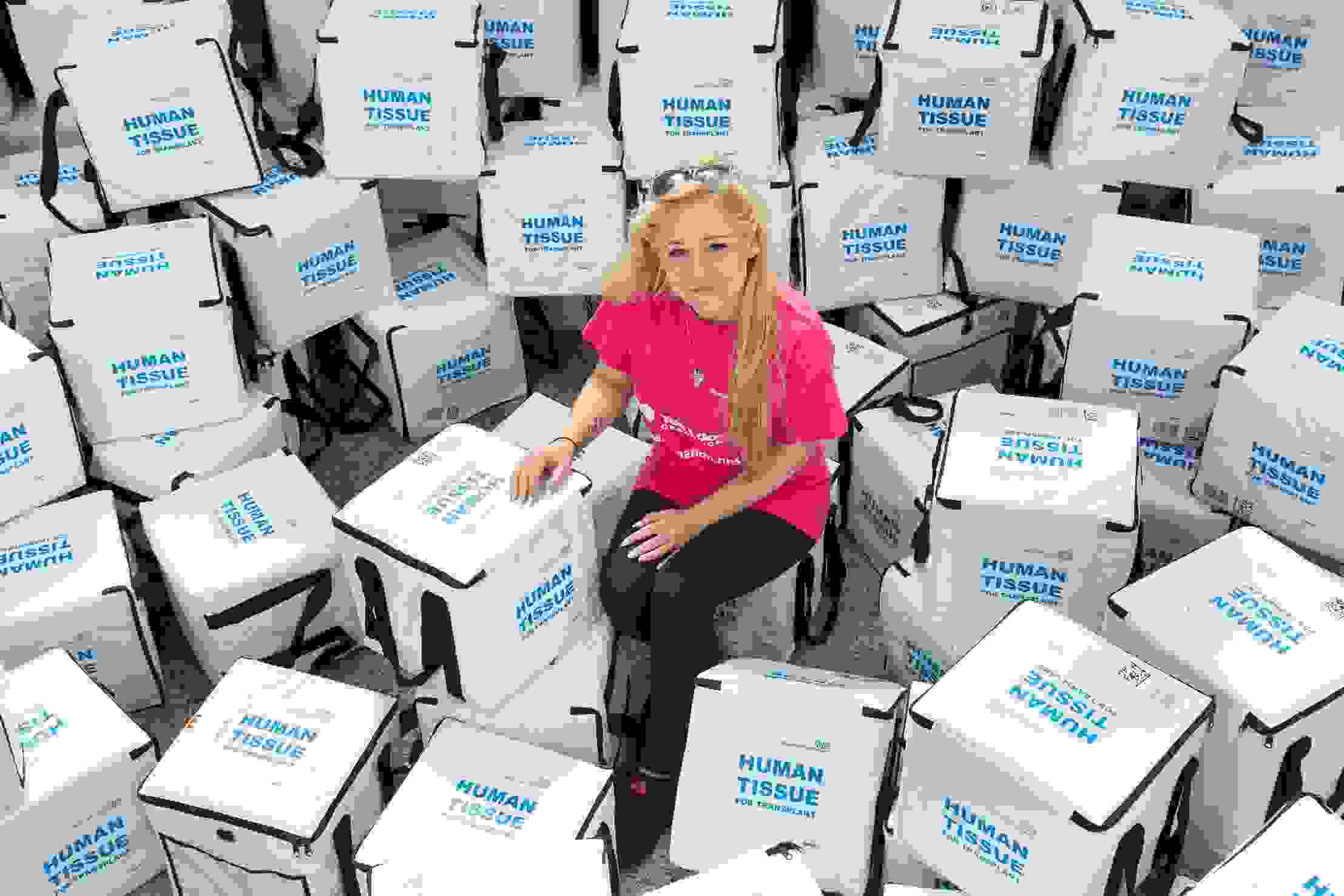 Izzy Sewell with empty transplant boxes at NHSBT Bristol Warehouse.JPG