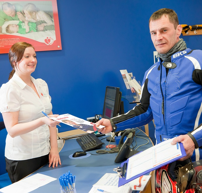 Blood donor receiving his welcome leaflet