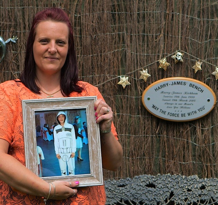 Dawn Kirkham holding a photo of her son, Harry-James