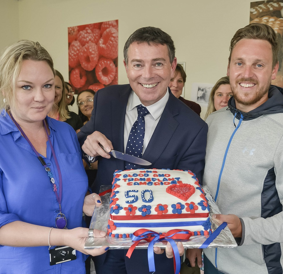 NHSBT Chief Executive, Ian Trenholm, holding the anniversary cake