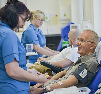 A man donates blood at Cambridge Donor Centre