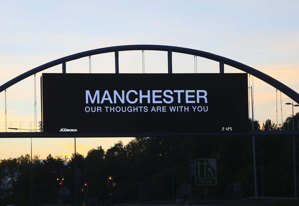 Road sign saying Manchester our thoughts are with you