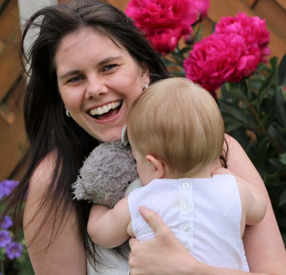Nicole holding her baby