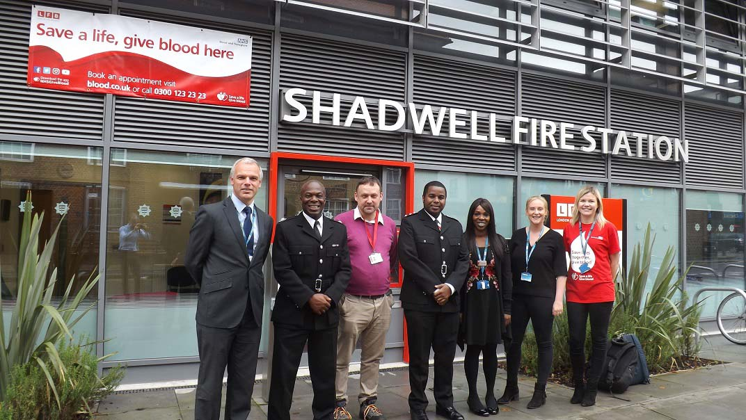 Director of Blood Donation Mike Stredder and Senior Sister Ebony Dunkley with staff at Shadwell Fire Station.