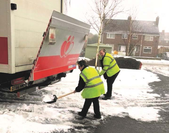 Donor carers clearing the snow