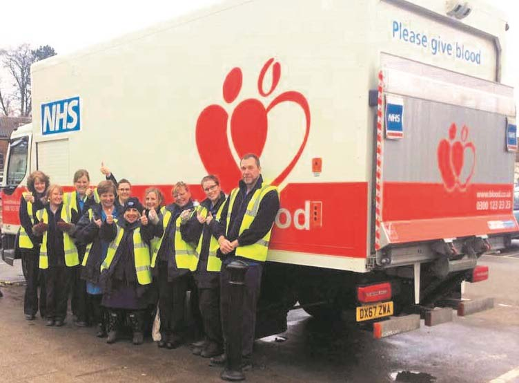 Thetford team alongside a blood donation truck