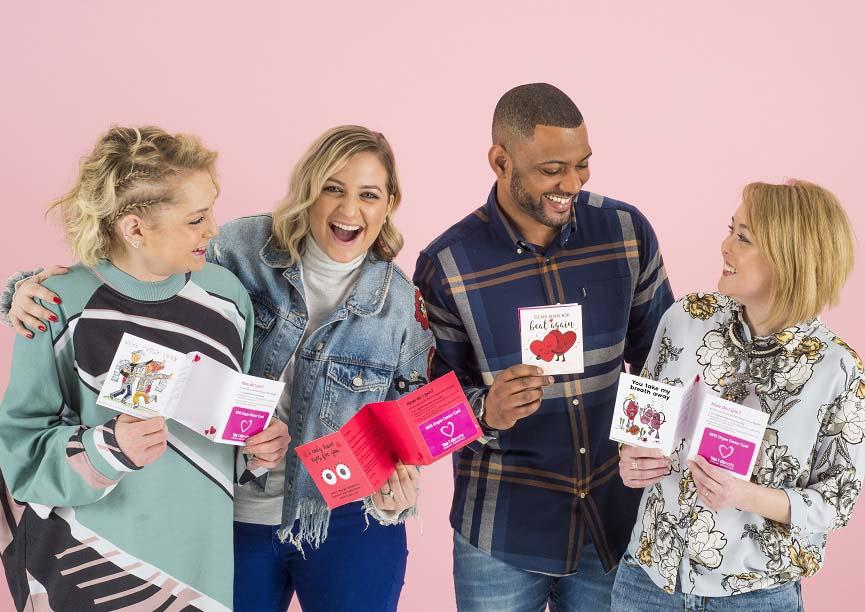 Jess, Kim, JB Gill and Chloe holding Valentine's organ donation Moonpig cards