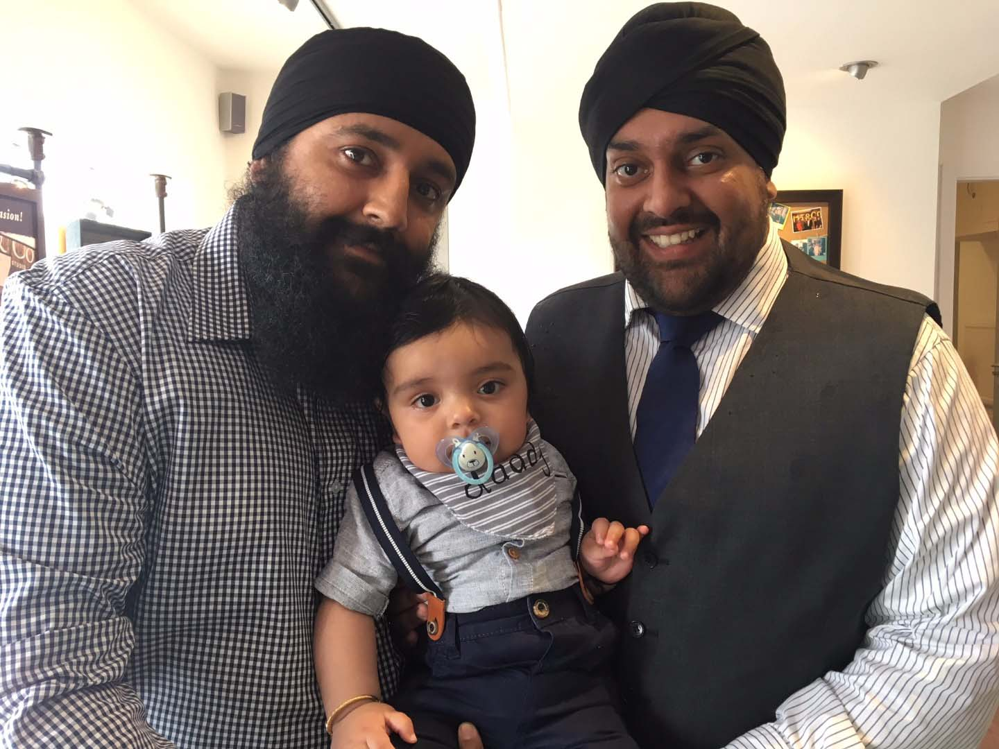 Gurpeet Singh (left) and his son Jorawal with Manpreet Singh (right)