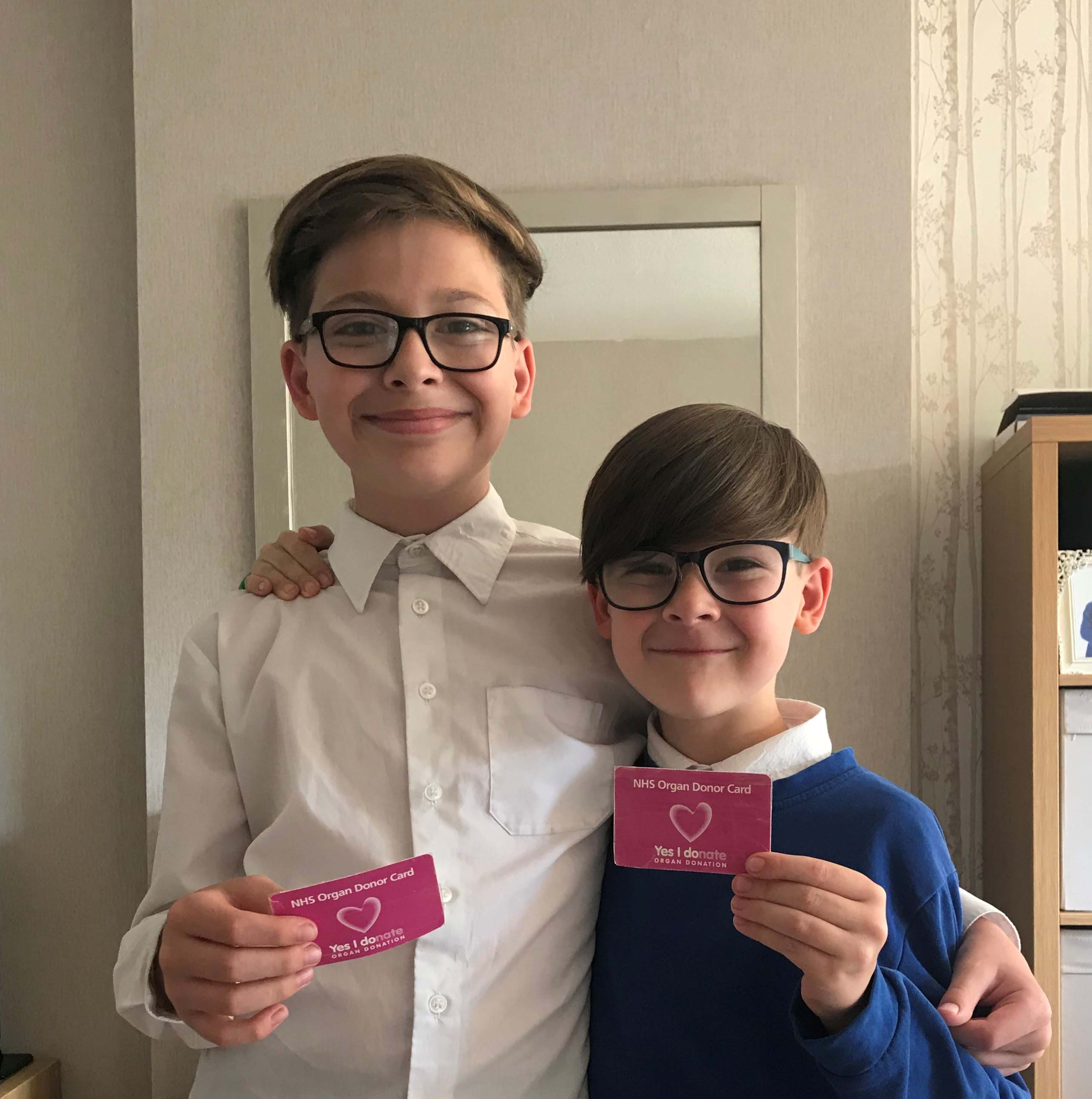 Gemma's sons hold their organ donor cards