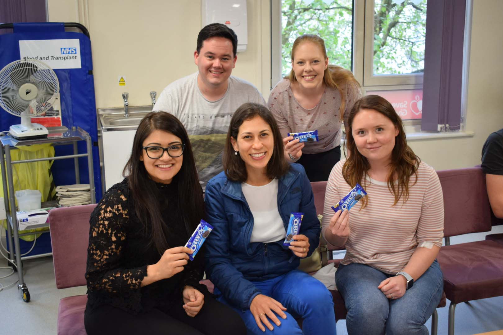 The Cadbury donors enjoy a biscuit after giving blood