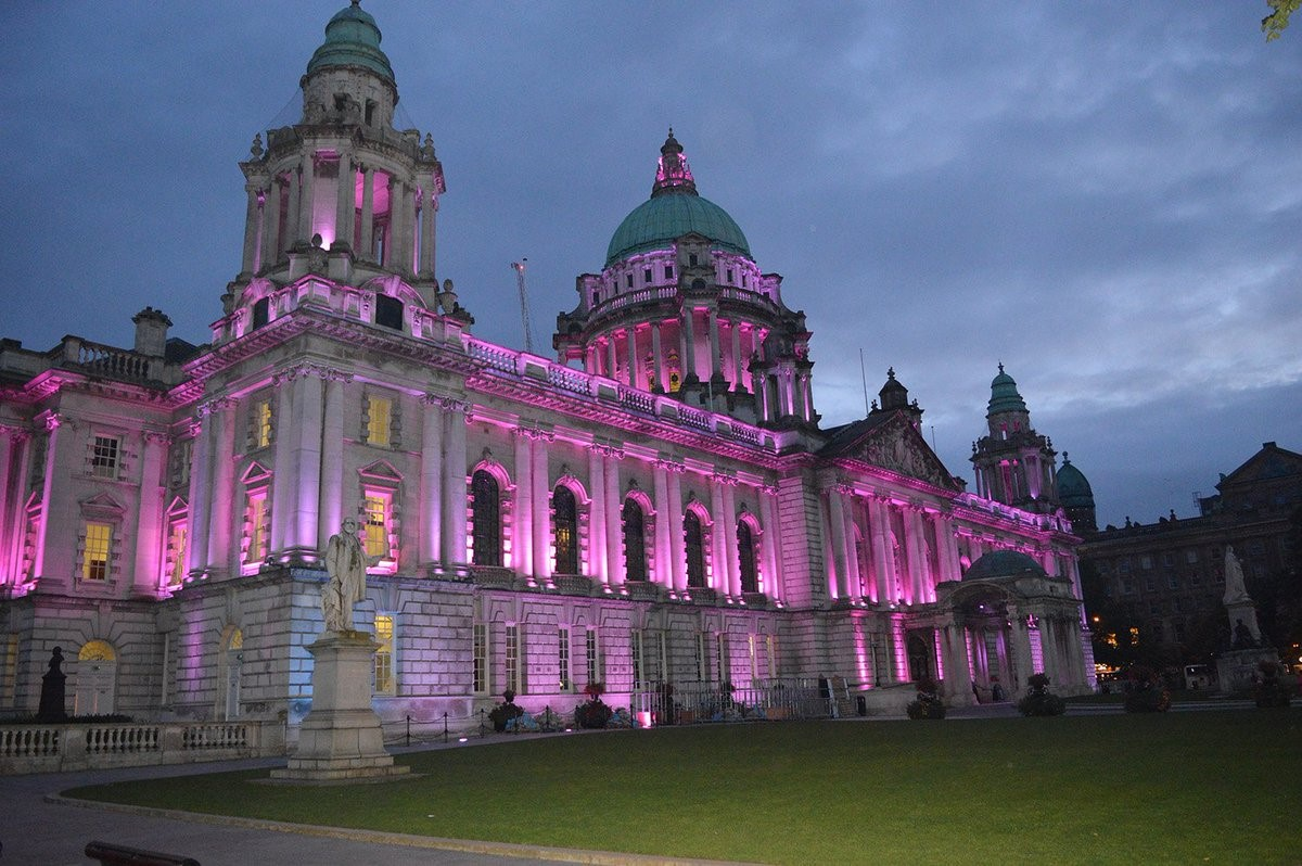 Belfast city hall lit with pink