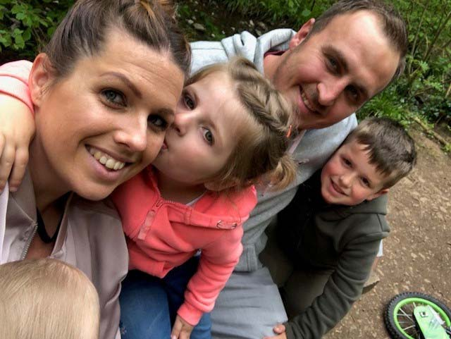 Nathan with his wife and children