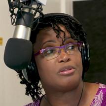 Primrose with headphones on, presenting her radio show