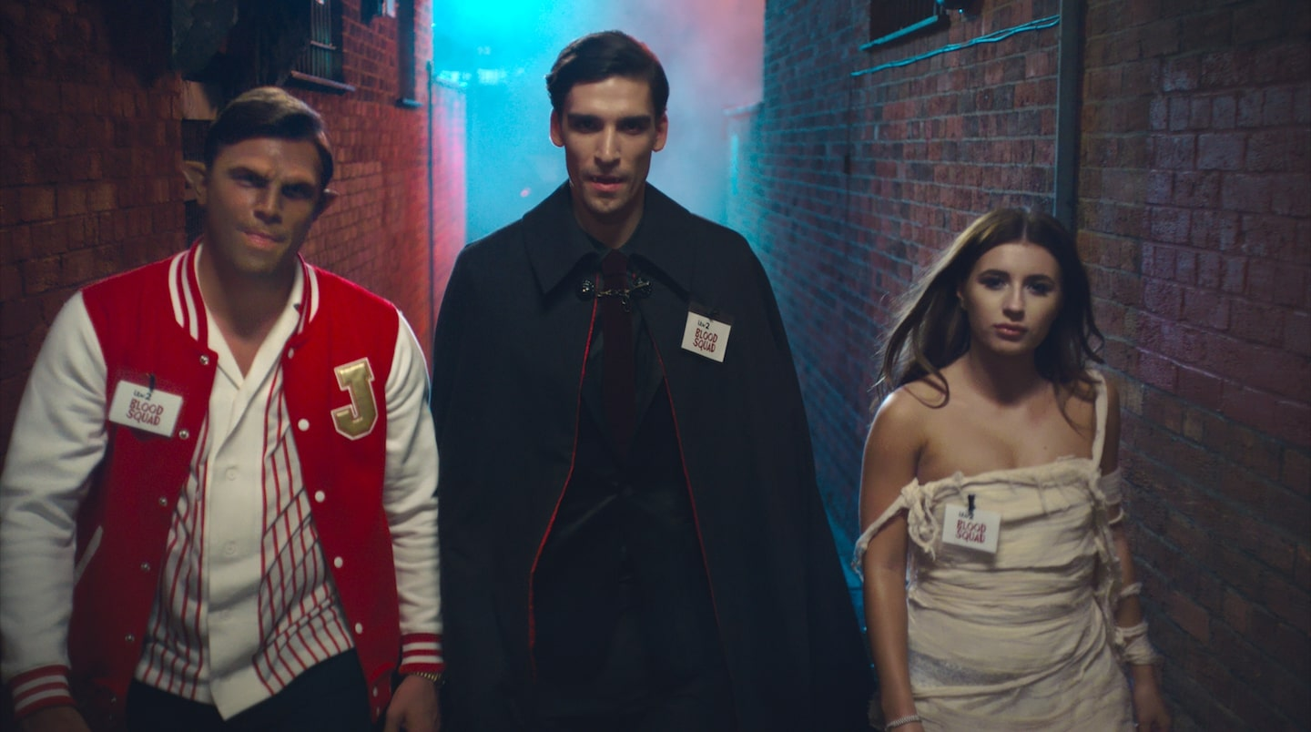 Three of the Blood Squad in Halloween costumes