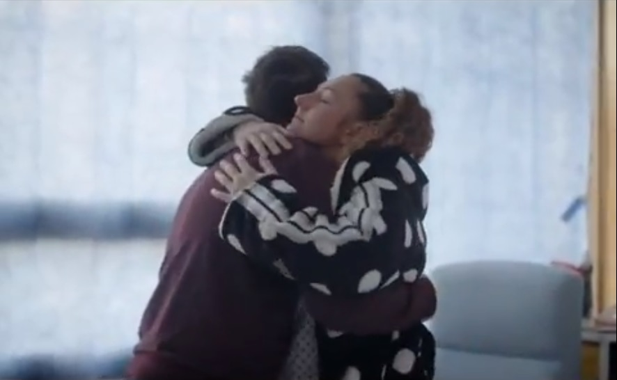 Kidney donor Collette and her older brother embrace