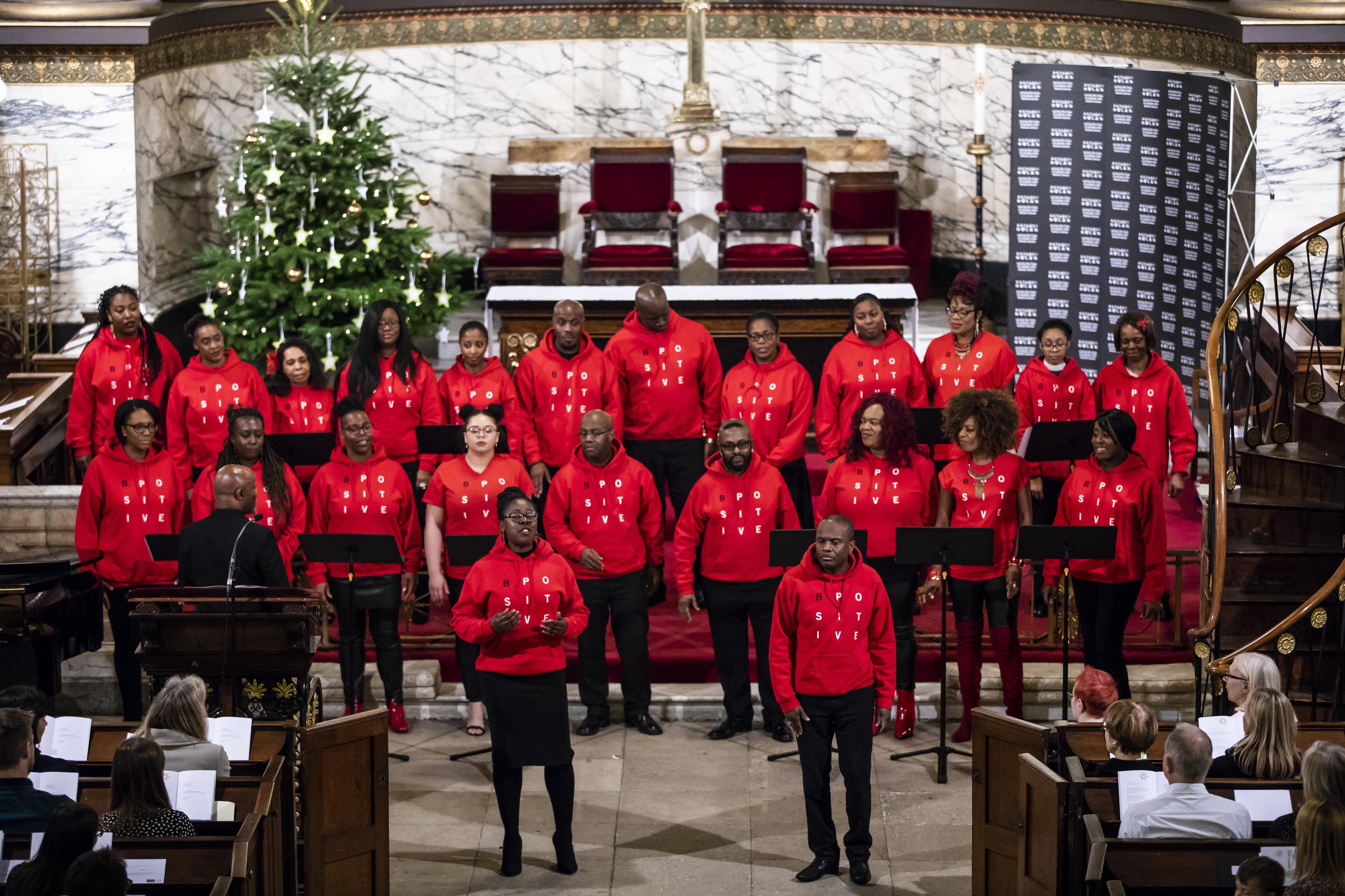 The choir (wearing red hoodies) perform at St Pancras Church