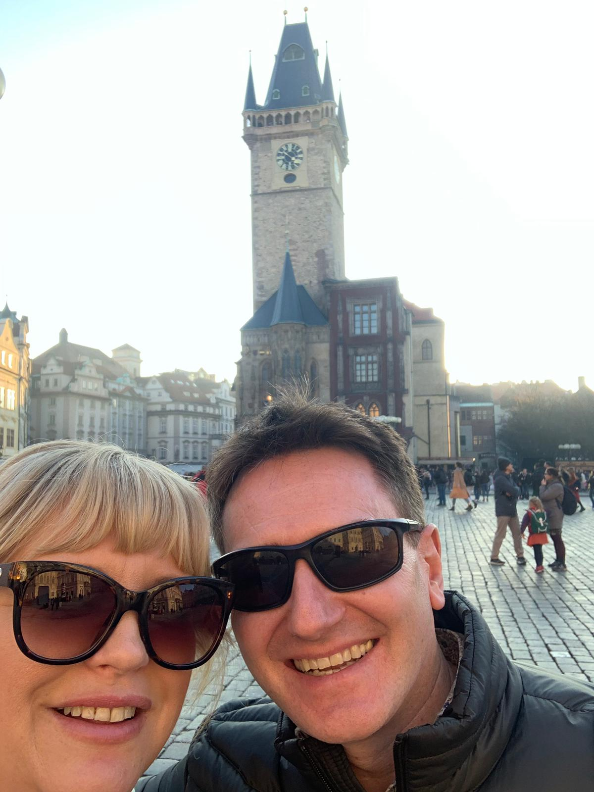 Anthony and his wife Rachel pose for a selfie by a church in Prague