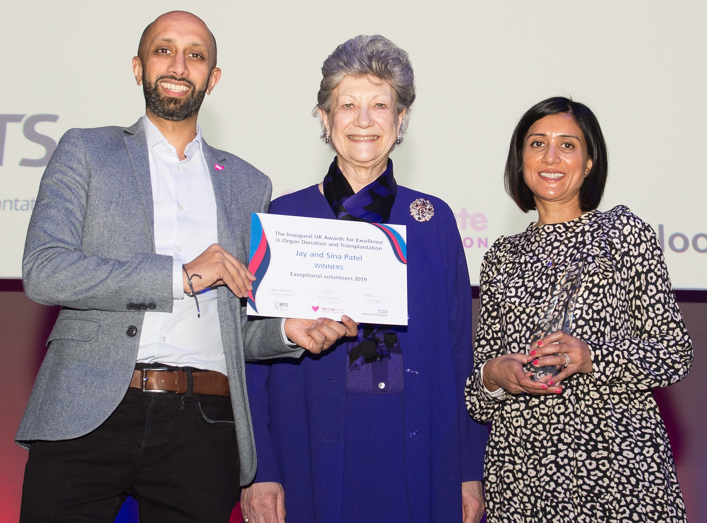 Jay and Sina Patel receiving the Exceptional Volunteer award