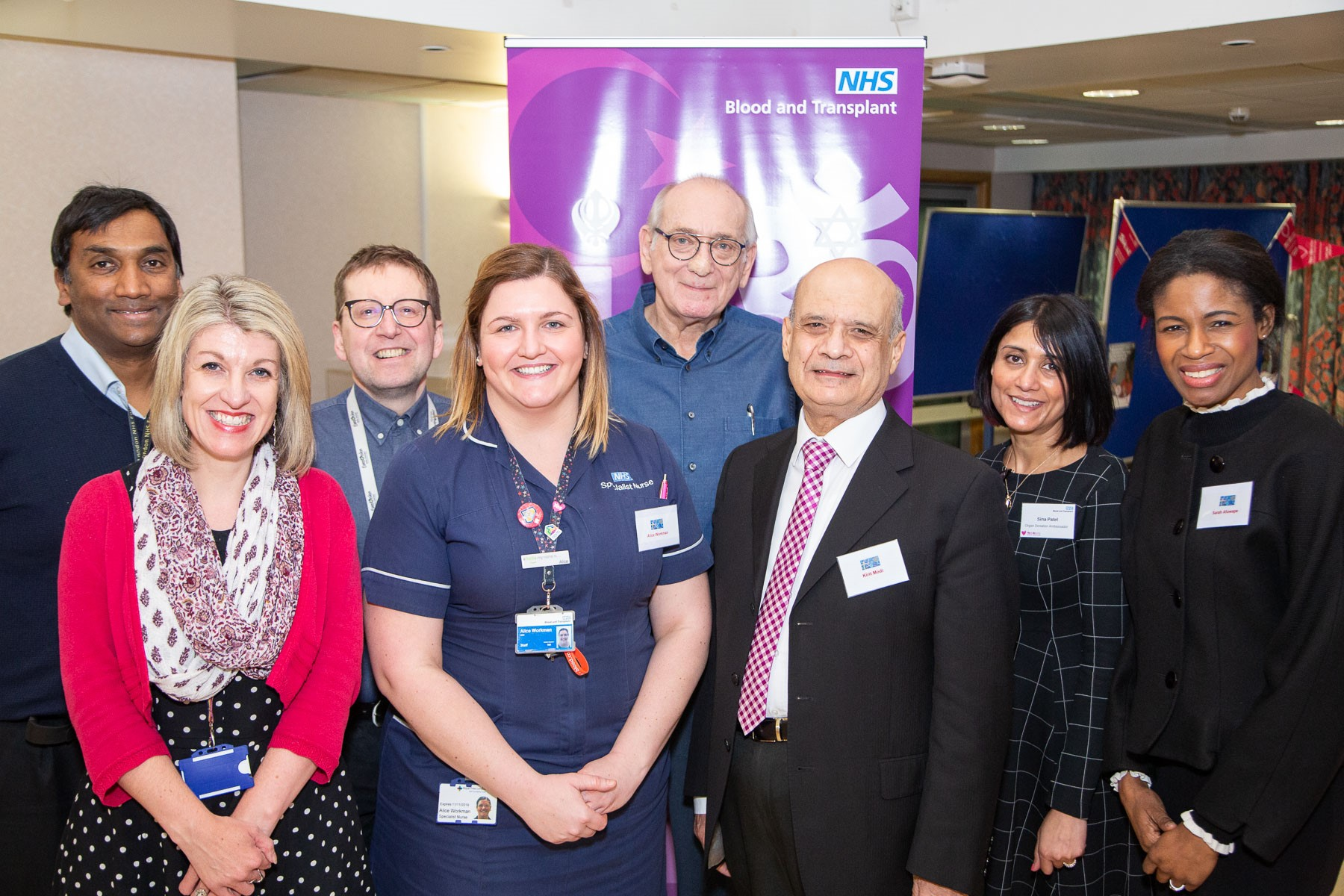 Attendees of the event pose for a photo, including healthcare professionals, a transplant recipient and campaigners