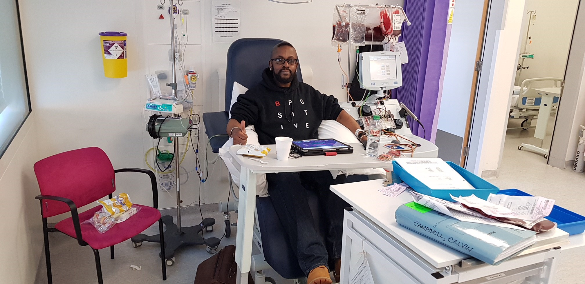 Sickle cell patient and B Positive choir member Calvin Campbell receiving blood