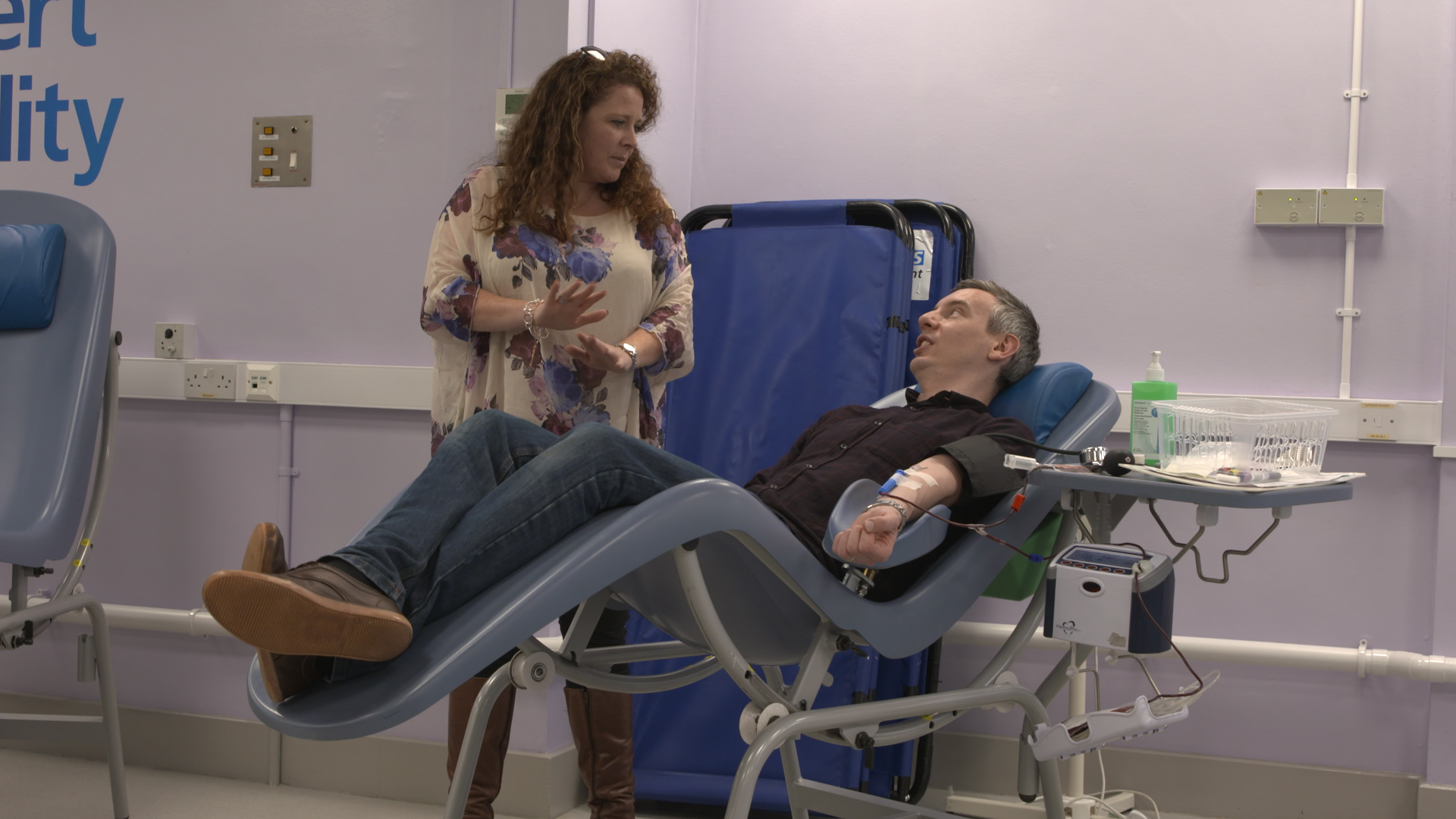 Karl chats to Emily while giving blood
