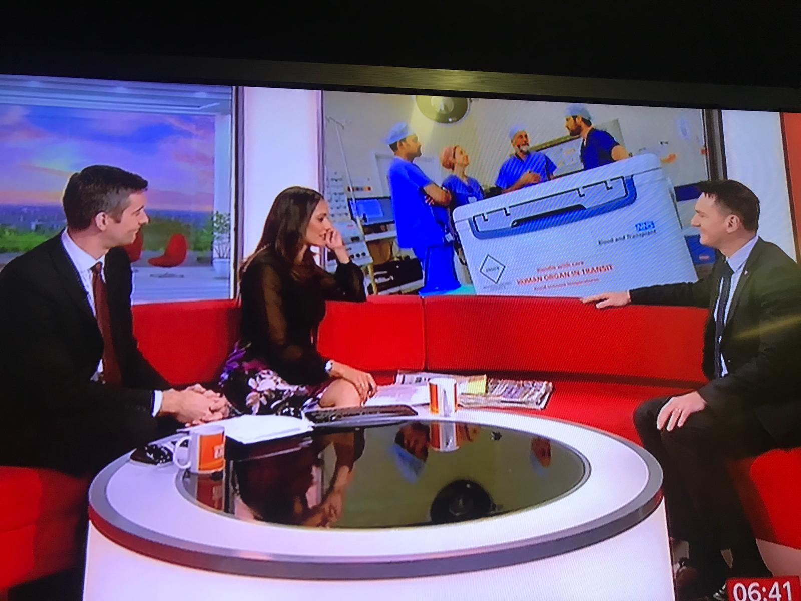 Anthony is interviewed on TV by two presenters