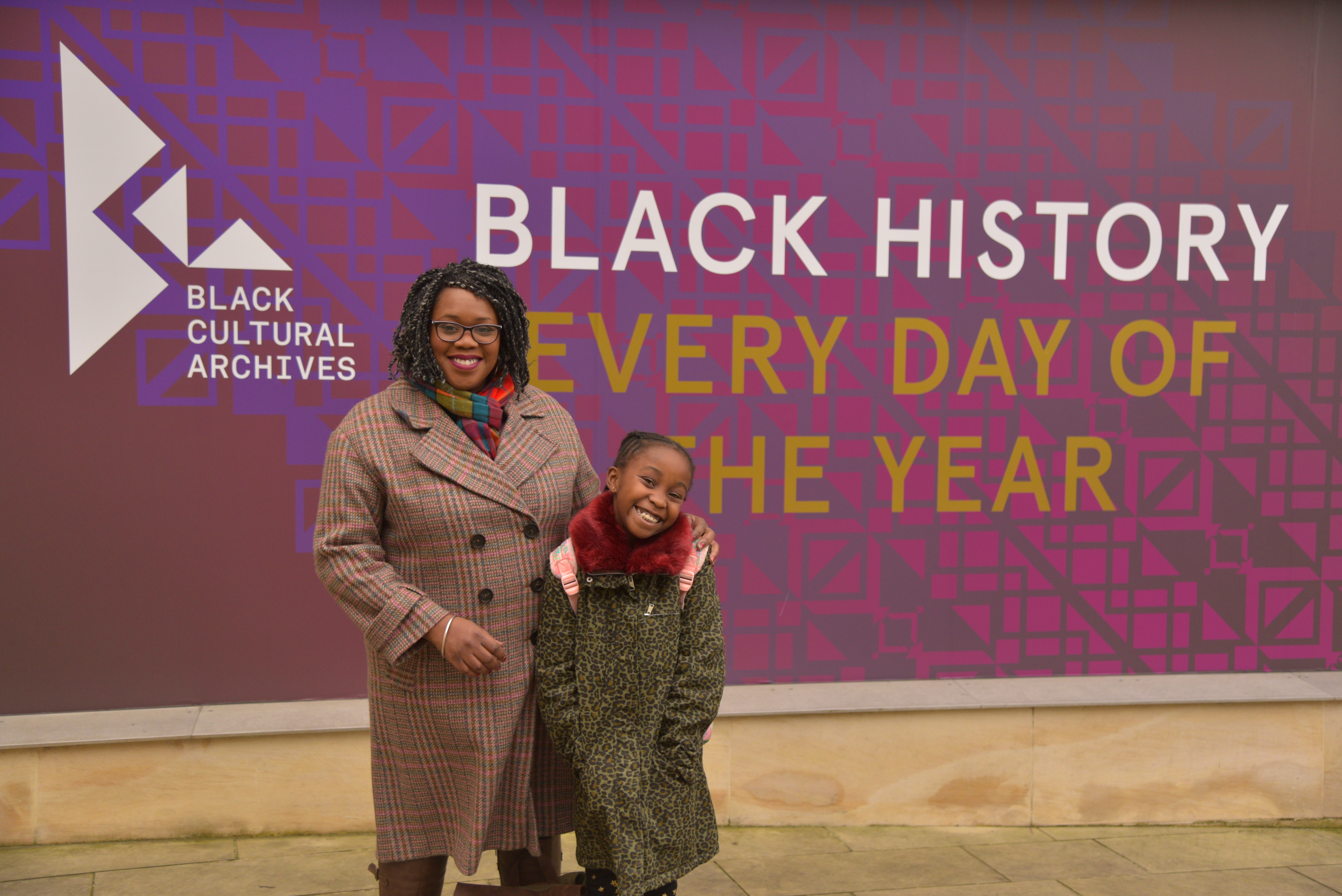 Lisa Phillip with daughter Miai visiting the Black Cultural Archives, London