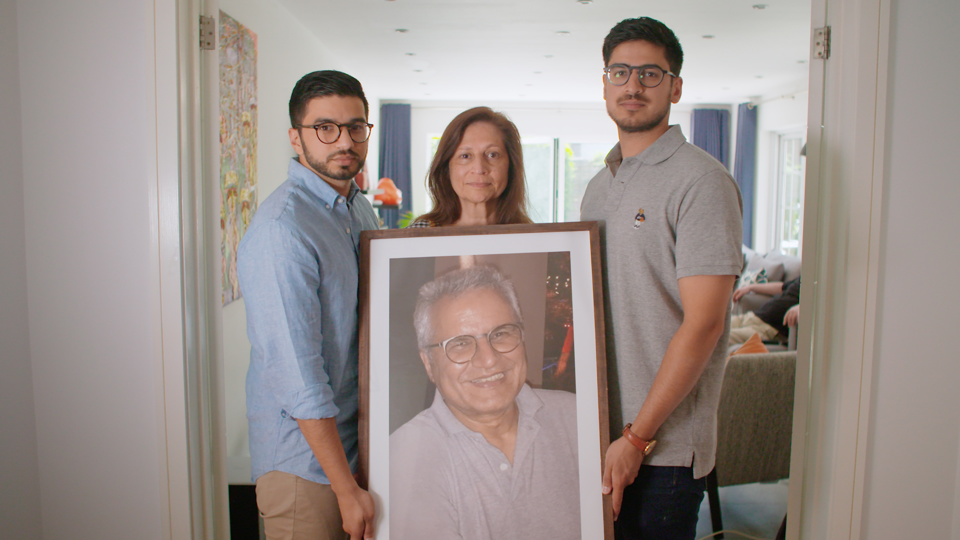 The Kakkad family with a photo of father, Bharat, who died and donated his organs early in 2019