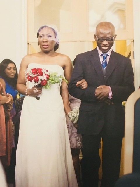 Henry walks his daughter Ebuzo down the aisle on her wedding day