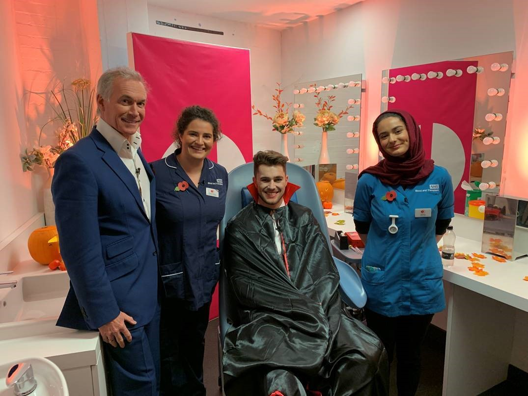 Curtis, dressed as a vampire, with Dr Hilary Jones, a nurse and a donor carer