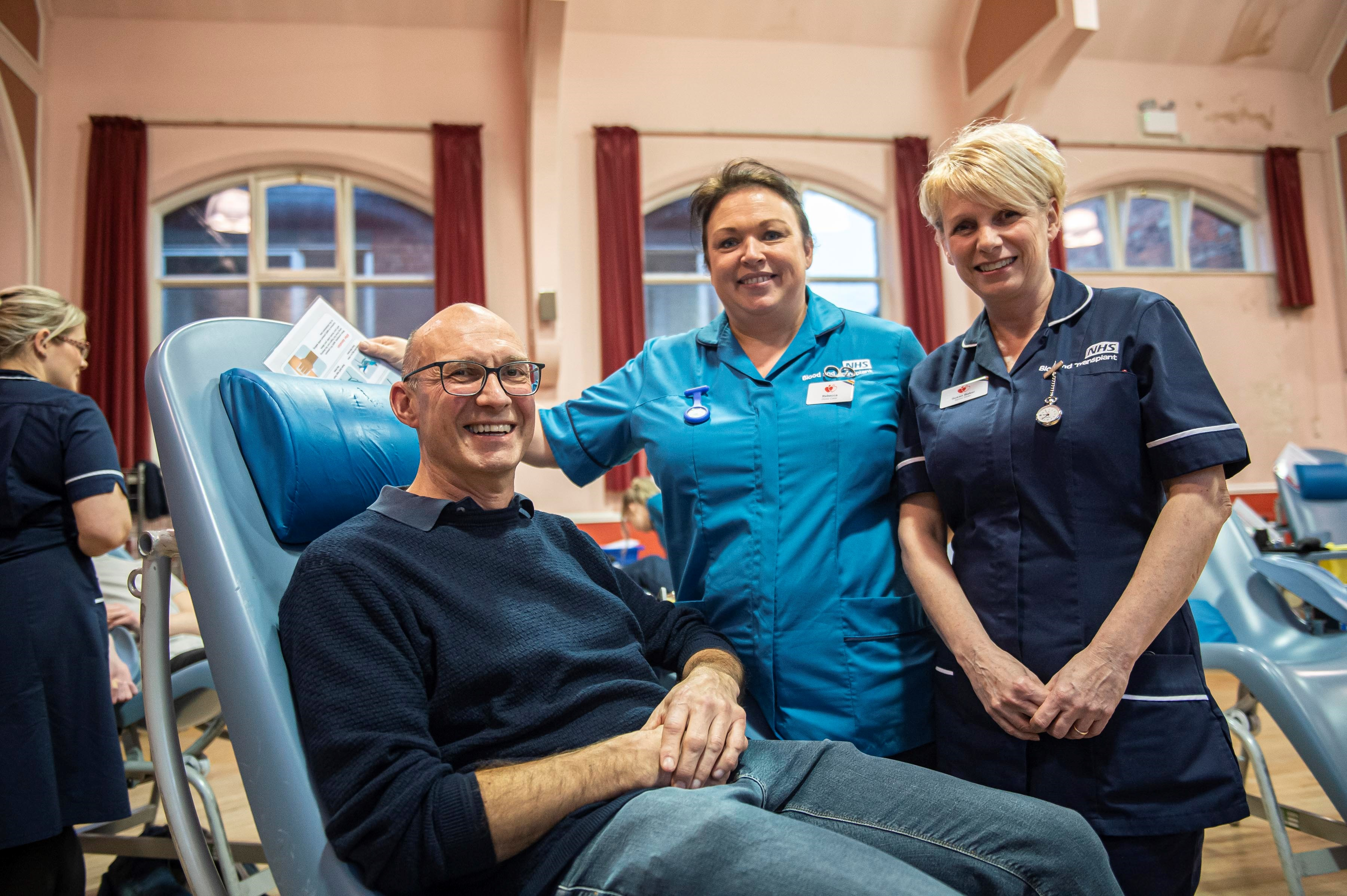 Bob Downes with donor carer Rebecca Morton and senior sister Susan Baker