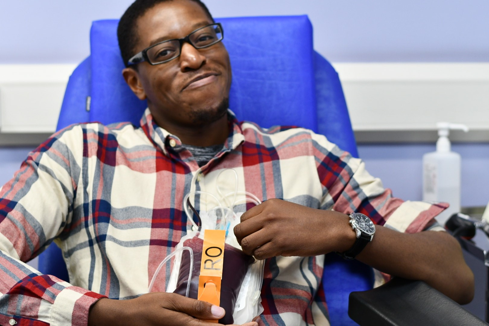 A male donor holds his blood donation