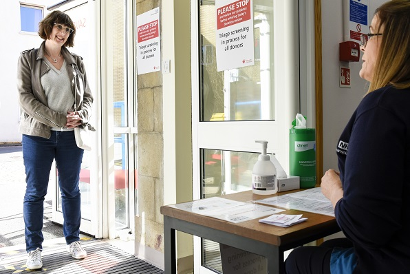 A donor speaks to member of staff before coming to donate