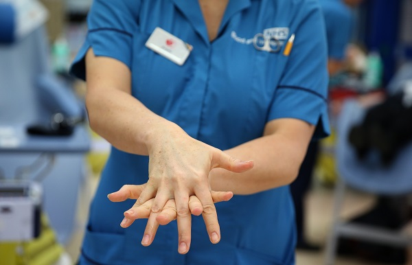 A donor carer washed between her fingers using hand gel
