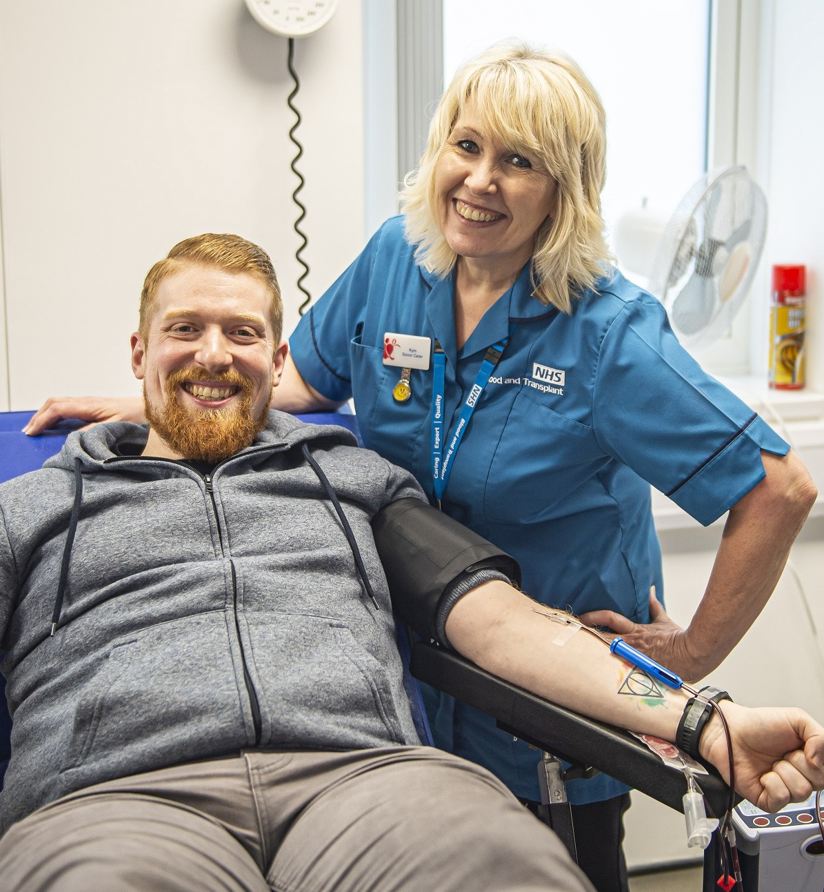 David Pulman and a Blood Donation nurse pose for a photo as David donates