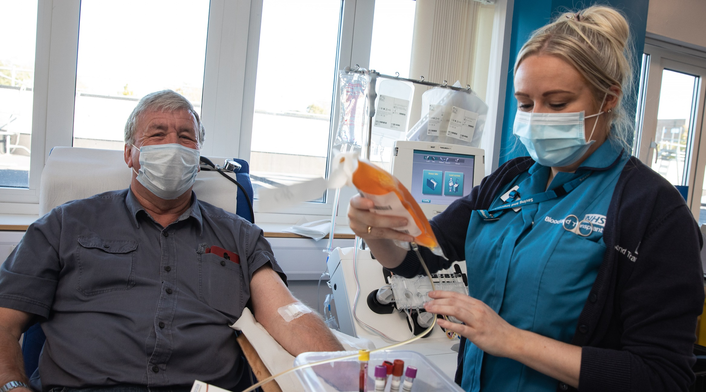 Alan Mack - donating plasma - and a donor carer