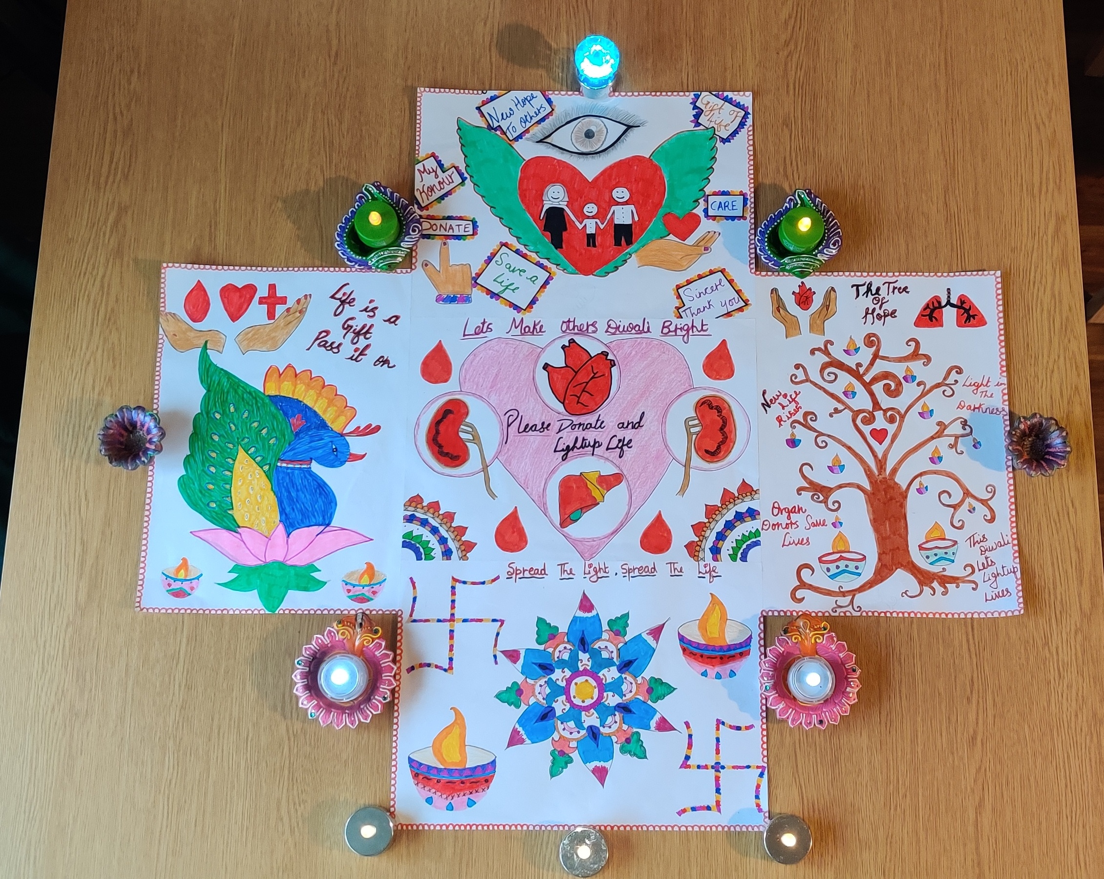 Prisha's artwork with candles around it
