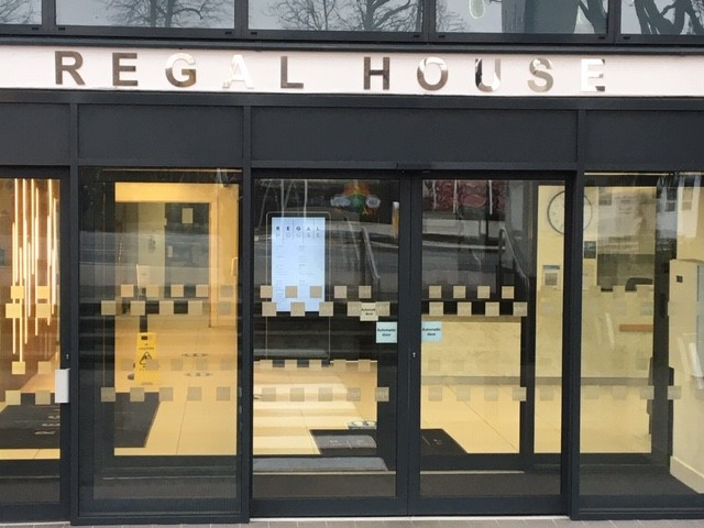 The entrance to Regal House has glass sliding doors