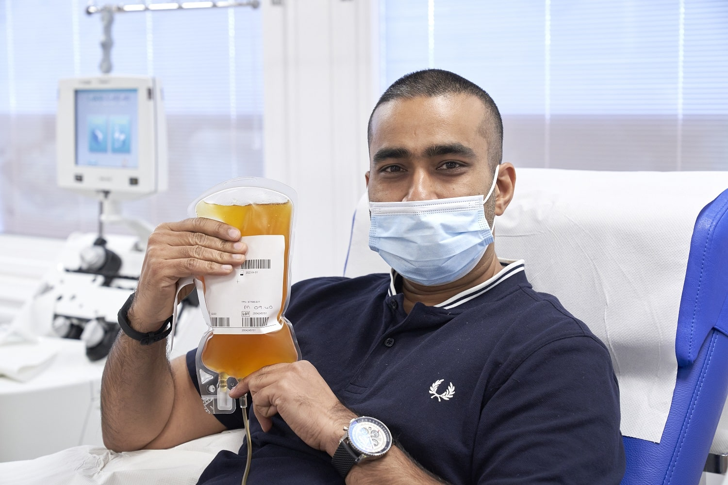 A donor holds a bag of his plasma
