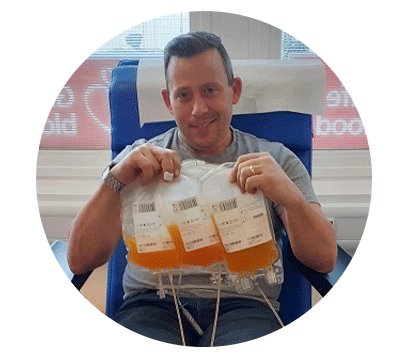 Mark holds three bags of platelets