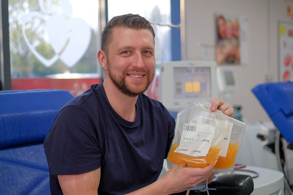 Pete holds two bags of his platelets