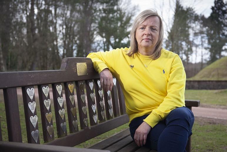 Elaine Kennedy sitting on a park bench