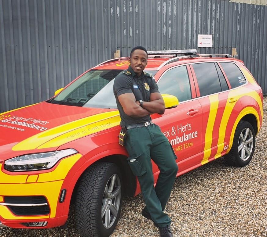 Tanoh stood next to an ambulance car