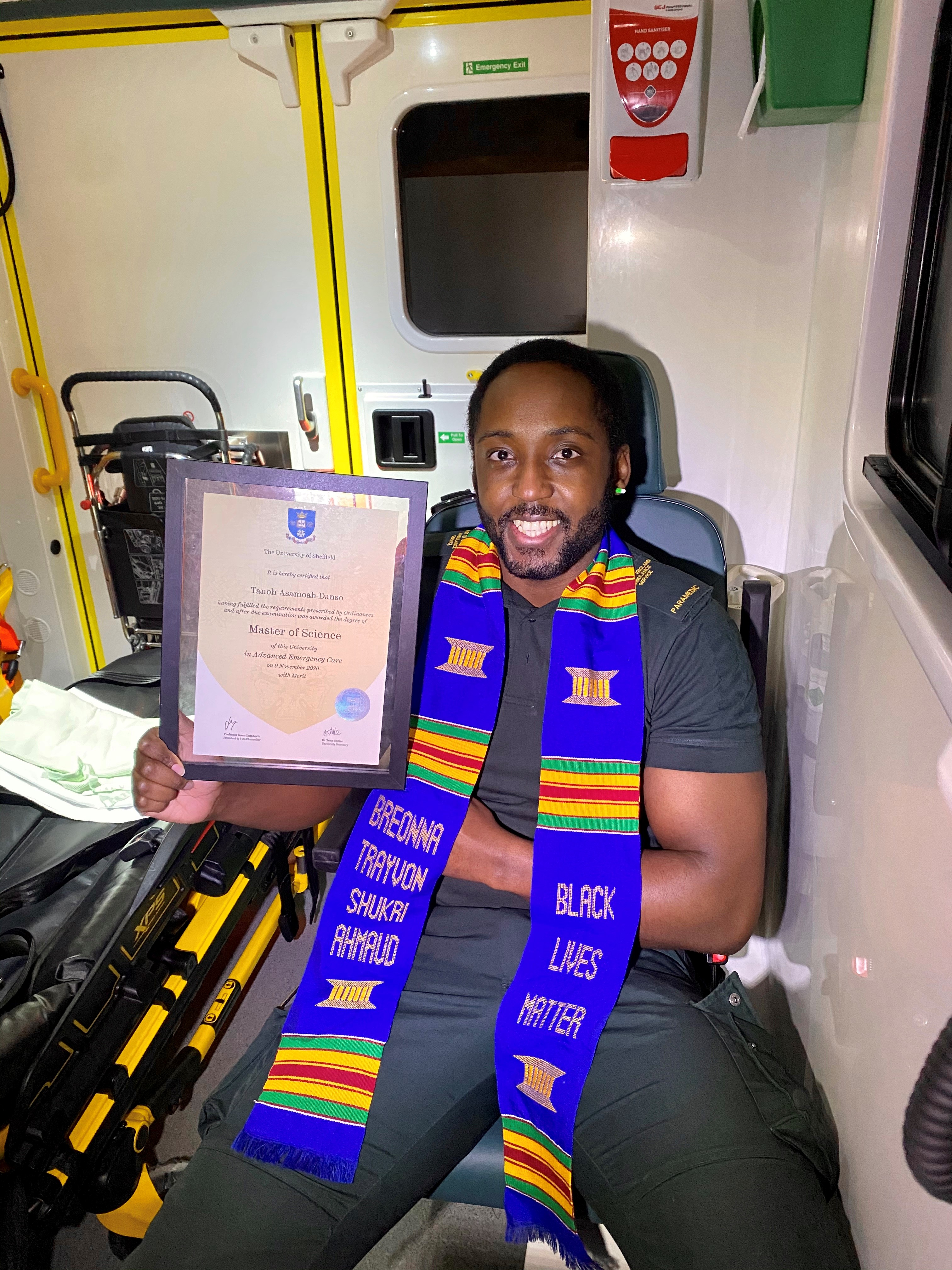 Tanoh holding his masters degree certificate