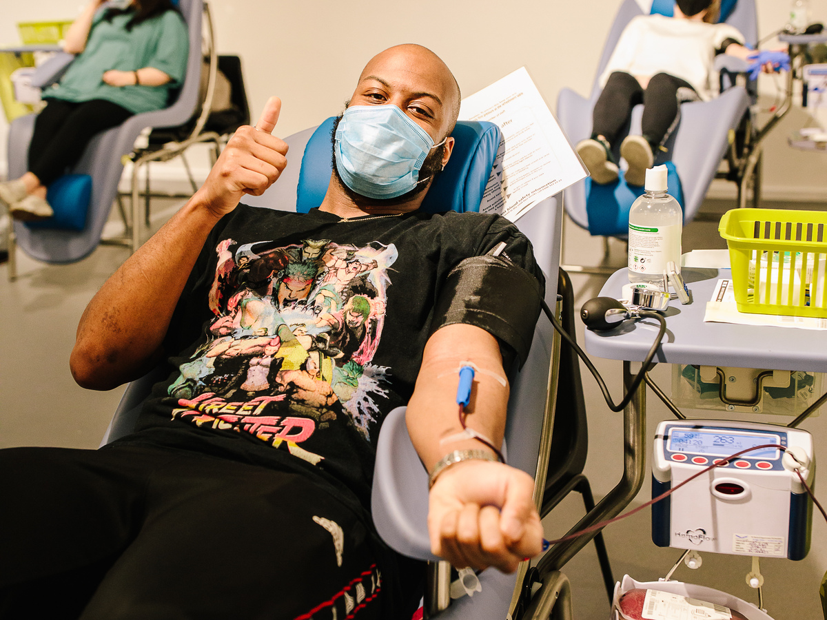 Man donating blood in chair