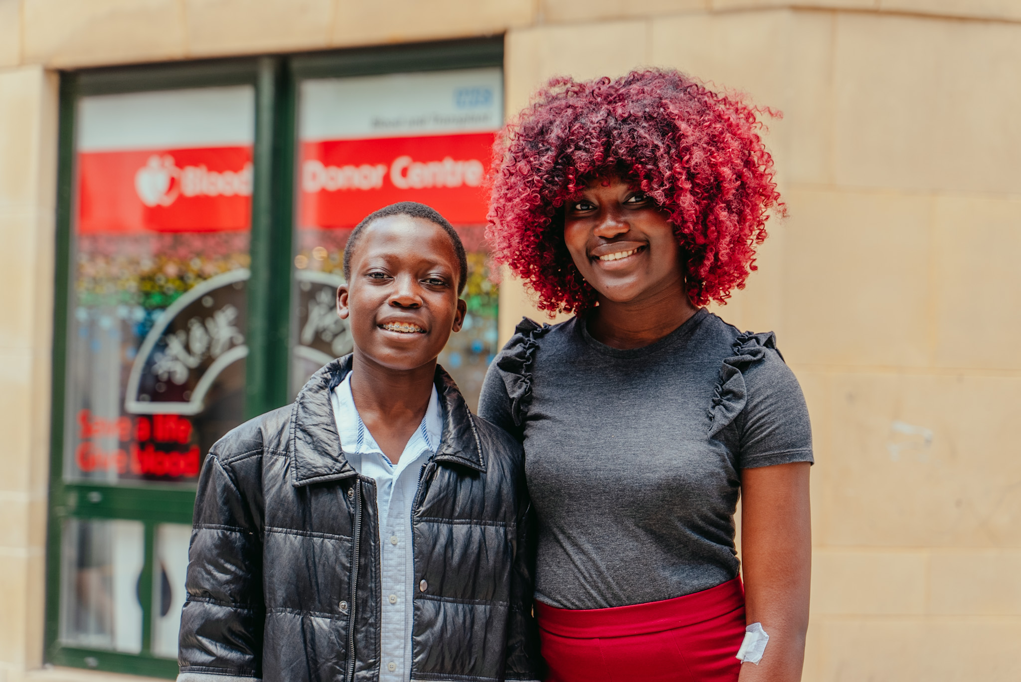 Zenith and her brother Charming outside blood donor centre
