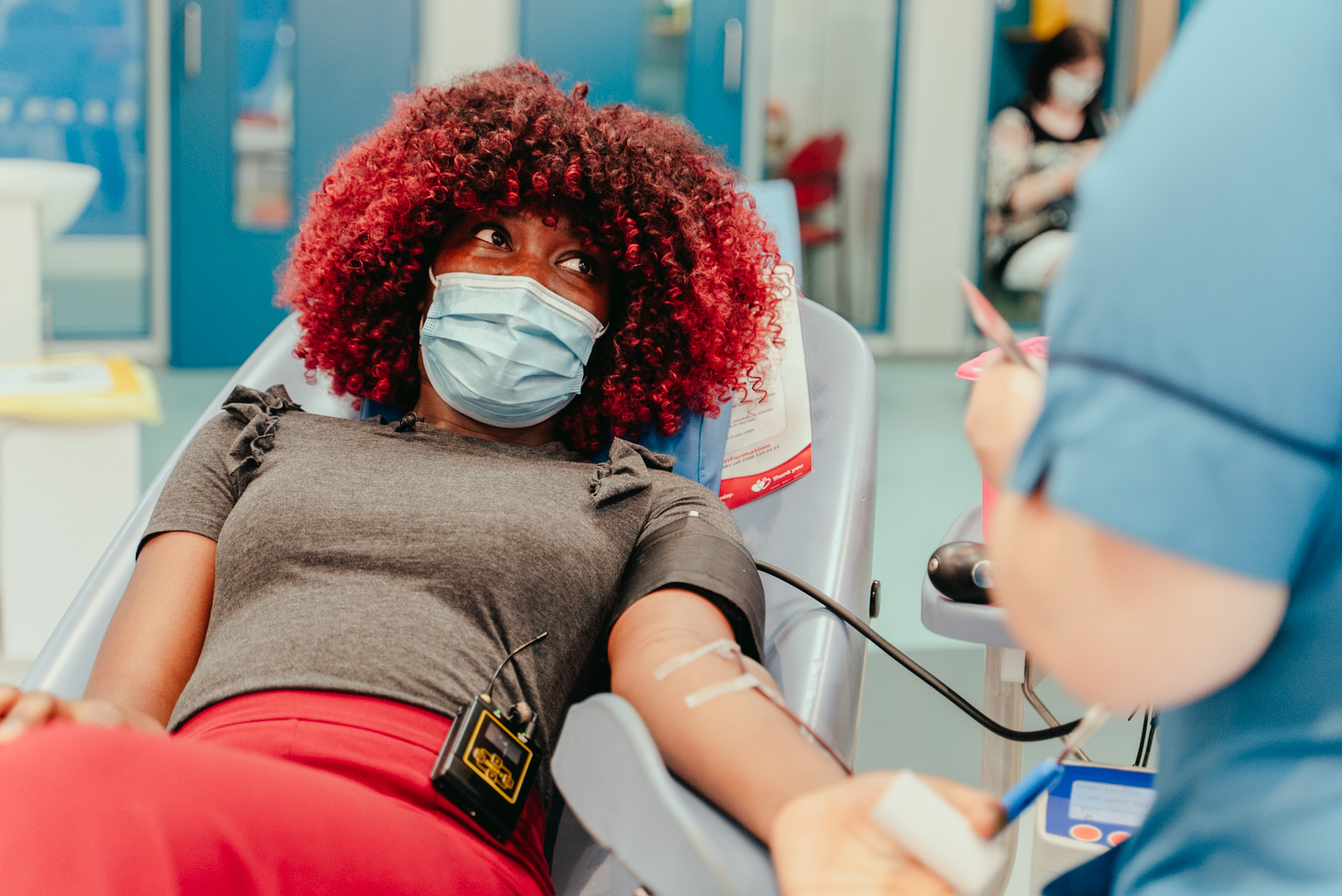 Charming's sister Zenith giving blood in the chair