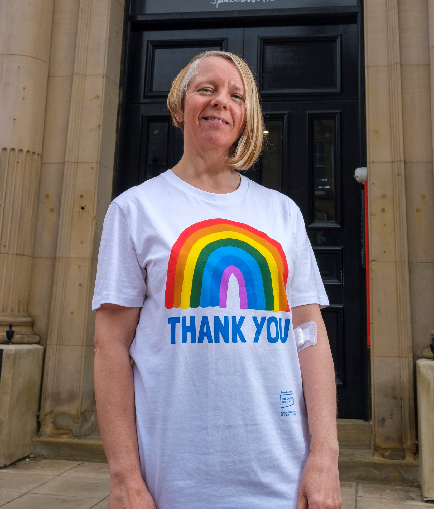 Karen wearing a white T shirt which says Thank you on it with a rainbow