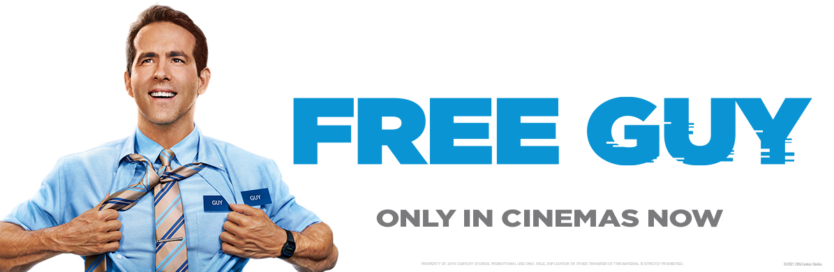 Free Guy promotional image. Main character (Ryan Reynolds) opening blue shirt in super hero style. Text reads 'Only in cinemas now'