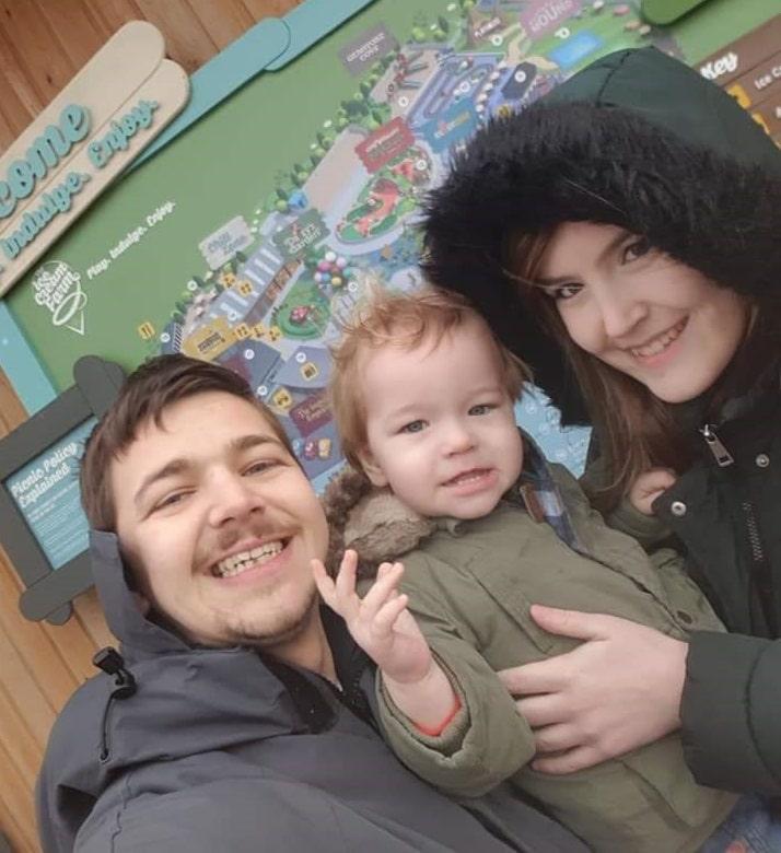 Kes, Trevor and her partner Luke in coats outside